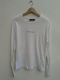 Basic Calvin Klein Jeans CKJ Long Sleeve Small Chest Spell Out Vintage 90s Unisex T-Shirt Size L by BubaGumpBudu on Etsy