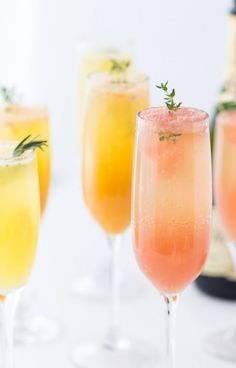A refreshing winter mimosa, this& Mimosa recipe is perfect for any weekend brunch with freshly squeezed grapefruit juice and fresh herbs. Summer Cocktails, Cocktail Drinks, Cocktail Recipes, Easter Cocktails, Champagne Drinks, Juice Drinks, Christmas Cocktails, Easter Recipes, Brunch Recipes
