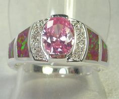 Pink Topaz with Opal insets.