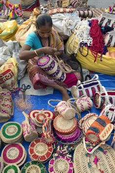 A woman engaged in making jute products Handicraft products of West Bengal are world famous Districts abound in artists making such products with the...