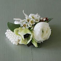Ranunculus, andromeda, anemone wrist corsage