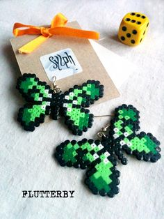 Green pixelated butterfly earrings made of Hama Mini Perler Beads in 8bit retro style by SylphDesigns