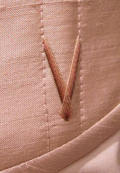 Flossing by hand on a Harman Hay corset.