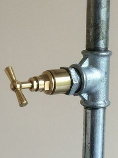 On / Off light switch just by a turn of the tap. Used on almost all the industrial pipe lamps created by www.vangael.be