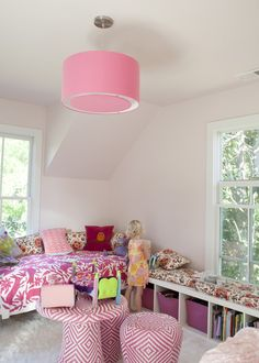 love the mix of pattern here in this pink girl's bedroom!