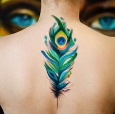 Pretty peacock feather tattoo by Magdalena