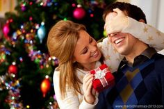 Christmas Gifts for Men 2013 Cute girl giving Christmas gift to her Men