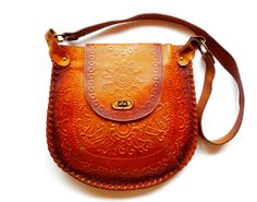 I need this bag! The intricate pattern on the vintage leather is beautiful.