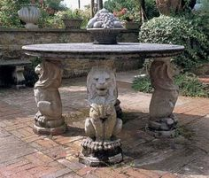 The Nevers Table is a cast stone circular dining table perfect for an outdoor garden dining area. The table is supported by a simple column in the center a