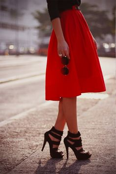 long red skirt, black heel sandals, black sweater tucked with black belt