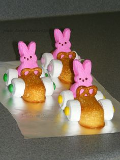 Easter Bunny Racers ------------ Here come the Easter bunnies speeding down the bunny trail!! All you need is Twinkies, bunny Peeps, large marshmallows, small round pretzels, M&Ms, and frosting or decorator icing for glue. Here comes mine, V-room, v-room!!
