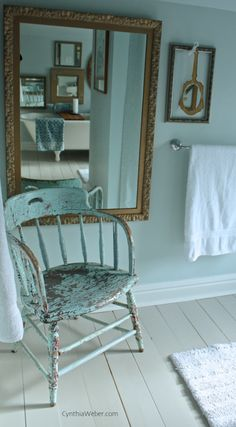 Chippy paint and gilt mirrors for a vintage inspired bathroom renovation #bathroom #vintage #CynthiaWeber.com