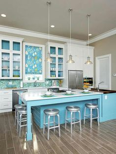 totally love the turquoise and white and the island with stools tucked neatly under!