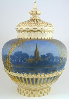 Antique Royal Crown Derby hand painted covered vase. Has scene depicting a church in a night time setting. Made in 1890.