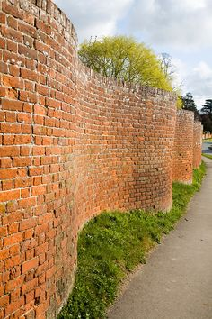 Red brick crinkle crankle or serpentine wall at Easton, Suffolk, England. I remember driving by this as a child.