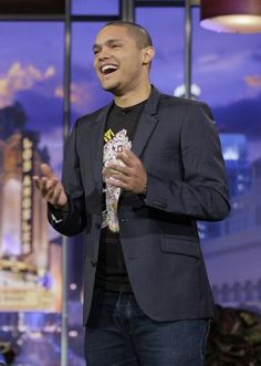 Trevor Noah may not be a household name yet, but he definitely has the comedy chops to take the reins from Jon Stewart. Late Night Comedians, Trevor Noah, Off The Charts, Jon Stewart, Song Play, T Baby, The Daily Show, People Laughing, Theme Song
