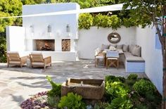 "This larger patio space designed by molly wood garden design is composed of two ""rooms"". there's the conversation grouping in front of the outdoor fireplace Outdoor Rooms, Outdoor Gardens, Outdoor Decor, Outdoor Seating, Built In Garden Seating, Wood Gardens, Outdoor Kitchens, Extra Seating, Outdoor Lounge"