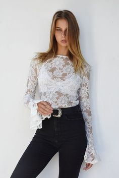 de176ec098 Delicate sheer daisy lace blouse with dramatic large floaty bell sleeve  detail. Tuck into your high waist black skinnies and wear with your