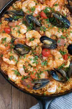Seafood Paella with Shrimp, Sausage, and Tomatoes Recipe on Yummly. @yummly #recipe