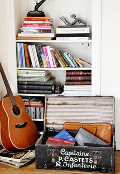 some many things in this corner tug at me - the old army trunk, bound books and cds and the well used guitar.
