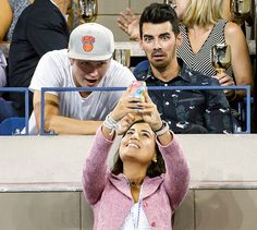 Ansel Elgort and Joe Jonas mug for a photo at the Men's Singles Quarterfinals at the 2014 U.S. Open in New York City