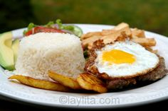 Ecuadorian churrasco plate: steak topped with egg, rice, plantains, fries and salad