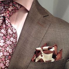 Brown suit / pink floral tie/ brown and white pocket square                                                                                                                                                                                 More