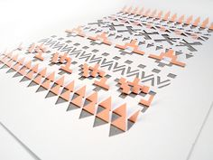 Aztec Papercut by all things paper, via Flickr. Just one more way you could utilize stencils!