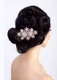 The Bernadette Clip by Sara Gabriel.  This Swarovski filigree brooch can be worn in your hair or pinned to your dress!