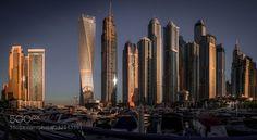 Dubai Marina Morning - Pinned by Mak Khalaf Pano 3 images wide and 2 high covering some of the most famous buildings in the Dubai Marina at early morning City and Architecture BoatsBuildingsDubaiDubai marinaPanoramaSkyscrapersSunriseSunshineUAElightseasunlight by Ljamoller