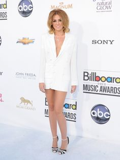 Miley Cyrus' Red Carpet Style EvolutionMiley blended in with the background at the 2012 Billboard Music Awards as she arrived in an all white outfit. (But all that skin she is showing helps us spot her!)Photo: Getty Images