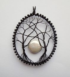 Moonrise wire wrapped tree pendant with freshwater pearl moon. £24.00, via Etsy.