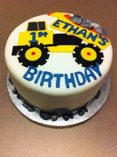 dumptruck cake @ Noah's request. I think I could do this, though I wouldn't do the main icing fondant...