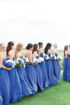 Bridesmaids At Ceremony Wearing Periwinkle Dresses And Carrying Bouquets