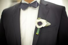 anemones are huge right... and go well with the other more masculine options listed before. :)