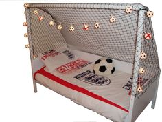 This sturdy and creative goal bed has the frame raised on the 3 sides where the netting is for safety. Description from smashinglists.com. I searched for this on bing.com/images