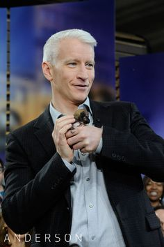 oh my gosh... anderson, who I love dearly, holding Beyonce, the world's smallest dog. IT DOES NOT GET BETTER