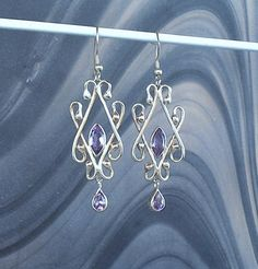 Items similar to Sterling Silver Filigree Chandelier Earrings with faceted pear and marquise Amethyst Gemstones. on Etsy Sterling Silver Filigree, Amethyst Gemstone, Chandelier Earrings, Range, Trending Outfits, Gemstones, Jewellery, Unique Jewelry, Handmade Gifts