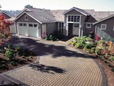 """A Truly Green Driveway Durable porous pavers are concrete or plastic blocks designed with holes that let you plant vegetation inside the blocks, creating a """"living"""" driveway. Description from pinterest.com. I searched for this on bing.com/images"""