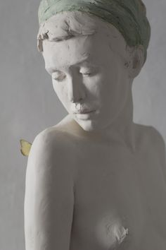 sculpture of girl with butterfly by Jeanne -Isabelle Cornière # butterfly#resin