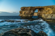 The Azure Window (Maltese: it-Tieqa Żerqa), also known as the Dwejra Window (Maltese: it-Tieqa tad-Dwejra), was a 28-metre-tall (92 ft) limestone natural arch on the island of Gozo in Malta. It was located in Dwejra Bay, within the limits of San Lawrenz, close to the Inland Sea and the Fungus Rock, and was one of Malta's major tourist attractions. The arch, together with other natural features in the area, has appeared in a number of international films and media productions.  The formati...