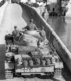 https://flic.kr/p/GW9Lbk | Panzerkampfwagen III (7,5 cm Kw.K. L/24) Tp (Sd.Kfz. 141/2) Ausf. N | Panzer III Ausf. N crossing a bridge in Tunisia, North Africa, 1943.  ________ The Panzer Pictures Database | @PanzerDB (Twitter) | panzerdb.com