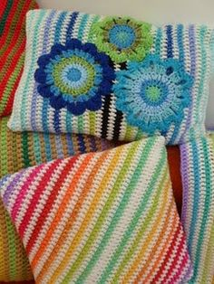 Happy, stripe-y, flowery crocheted pillows.