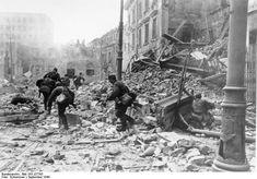 SS-Sonderregiment 'Dirlewanger' troops on ul. Focha Street attack towards Town…