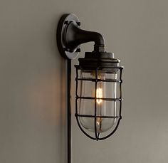 RH an antique ship light, our wall sconce comes complete with a distinctive metal cage designed to pr