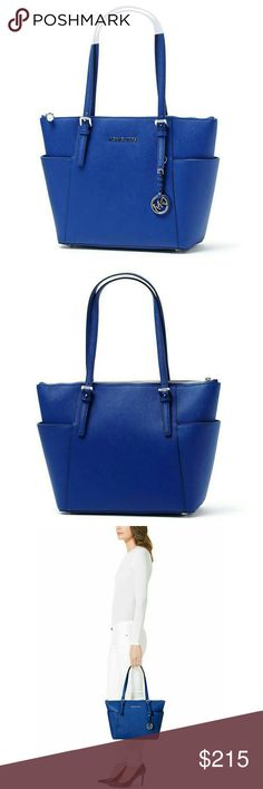 New! MICHAEL KORS Leather Tote Bag Electric Blue Crafted from luxe leather, this tote carries your everyday essentials in designer style.  *** SORRY, NO TRADES ***  Color: Electric Blue Leather Hanging MK logo silver-tone hardware Signature monogram interior. Top zip closure Buckled shoulder straps Exterior: 2 side slip pockets Interior: 2 front slip pockets, 2 back wall slip pockets, 1 back wall zip pocket. Double top handles 15-inch Width x 10.5 inch Height x 4.5 inch Depth Strap Length…