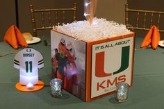 Our photo cube centerpieces were created to incorporate personal elements to your event. They have four sides for decorating with photos, team logos, clipart or anything else you would like. Photo Cubes, Baby Boy Themes, University Of Miami, 50th Birthday Party, Photo Logo, Bar Mitzvah, Custom Logos, Party Themes, Party Ideas