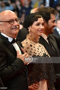 Iranian actor Babak Karimi, Iranian actress Taraneh Alidoosti and Iranian actor Shahab Hosseini pose as they arrive on May 21, 2016 for the screening of the film 'The Salesman (Forushande)' at the 69th Cannes Film Festival in Cannes, southern France. / AFP / ALBERTO