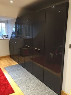 Believe it or not but these sleek grey gloss doors conceal clothing storage and a fully functioning kitchen.