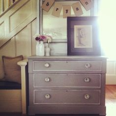Grey dresser with white wax. The Modern Cottage Company.